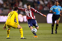 Midfielder Jorge Flores (19) of Chivas USA takes a shot on goal. Chivas USA and Columbus Crew played to a 0-0 tie at Home Depot Center stadium in Carson, California on  April  9, 2011....