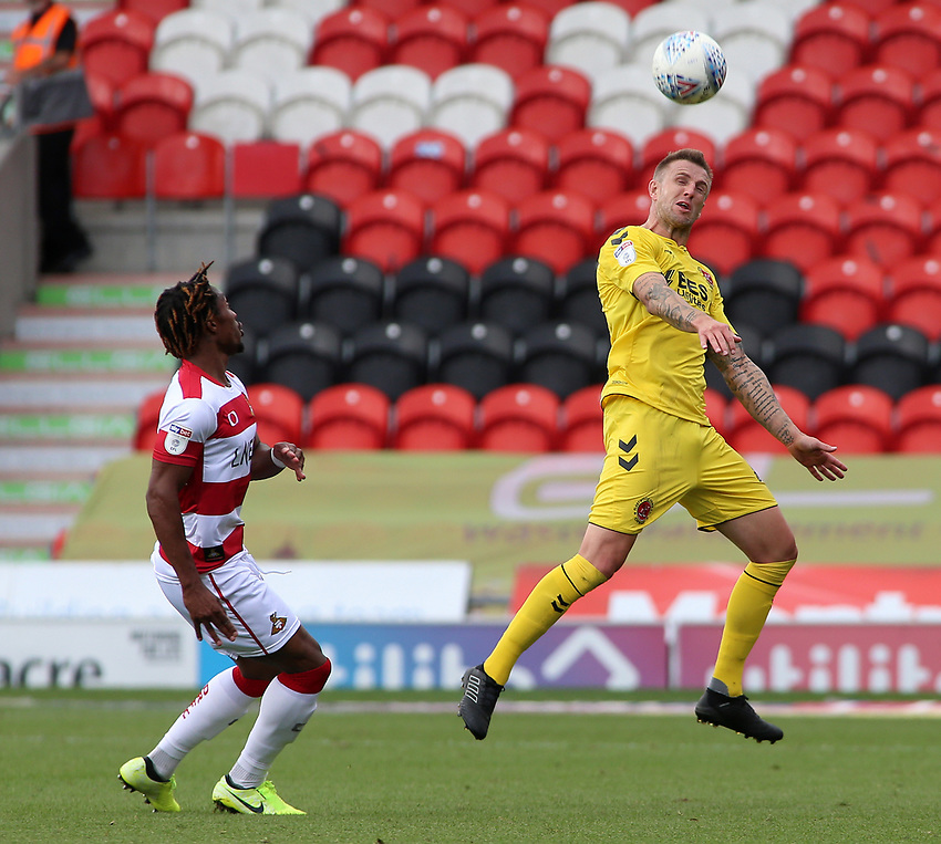 Fleetwood Town's Peter Clarke heads clear<br /> <br /> Photographer David Shipman/CameraSport<br /> <br /> The EFL Sky Bet League One - Doncaster Rovers v Fleetwood Town - Saturday 17th August 2019  - Keepmoat Stadium - Doncaster<br /> <br /> World Copyright © 2019 CameraSport. All rights reserved. 43 Linden Ave. Countesthorpe. Leicester. England. LE8 5PG - Tel: +44 (0) 116 277 4147 - admin@camerasport.com - www.camerasport.com