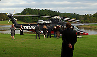Oct. 04, 2011 - Charlottesville, VA. USA; The Trump helicopter stands in the background during a press conference announcing the grand opening of Trump Vineyard Estates Tuesday in Charlottesville, Va. Trump purchased the foreclosed vineyard, previously owner by Patricia Kluge, at auction earlier this year. The 2,000 acre Trump Vineyard estate is also the home to Trump Winery, helmed by Donald's son Eric Trump. (Credit Image: © Andrew Shurtleff)