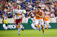 Brian Ching (25) of the Houston Dynamo and Heath Pearce (3) of the New York Red Bulls. The New York Red Bulls defeated the Houston Dynamo 2-0 during a Major League Soccer (MLS) match at Red Bull Arena in Harrison, NJ, on August 10, 2012.