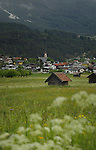 Tarrenz homes, church with cattle sheds in meadow foreground.Imst district, Tyrol/Tirol, Austria, Alps.