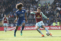 Burnley's Johann Gudmundsson passes under pressure from Leicester City's Hamza Choudhury<br /> <br /> Photographer Rich Linley/CameraSport<br /> <br /> The Premier League - Burnley v Leicester City - Saturday 14th April 2018 - Turf Moor - Burnley<br /> <br /> World Copyright &copy; 2018 CameraSport. All rights reserved. 43 Linden Ave. Countesthorpe. Leicester. England. LE8 5PG - Tel: +44 (0) 116 277 4147 - admin@camerasport.com - www.camerasport.com