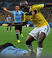 RIO DE JANEIRO - BRASIL -28-06-2014. Pablo Armero (#7) jugador de Colombia (COL) en acción durante partido de los octavos de final con Uruguay (URU) por la Copa Mundial de la FIFA Brasil 2014 jugado en el estadio Maracaná de Río de Janeiro./ Pablo Armero (#7) player of Colombia (COL) in action during the match of the Round of 16 against Uruguay (URU) for the 2014 FIFA World Cup Brazil played at Maracana stadium in Rio do Janeiro. Photo: VizzorImage / Alfredo Gutiérrez / Contribuidor