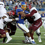 BROOKINGS, SD - OCTOBER 7: Mikey Daniel #26 from South Dakota State University drags a trio of defenders from Southern Illinois across the goal line in the first half of their game Saturday night at Dana J. Dykhouse Stadium in Brookings. (Photo by Dave Eggen/Inertia)
