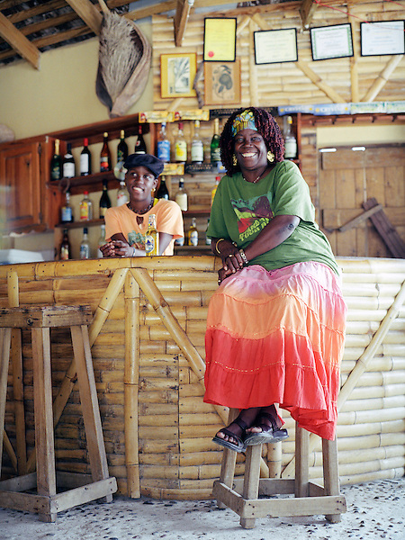 CAS EN BAS, ST.LUCIA : Marjorie Lambert owner of Marjorie's Beach Bar on Cas En Bas beach relaxes at her bar. Cas En Bas, St. Lucia, W.I.