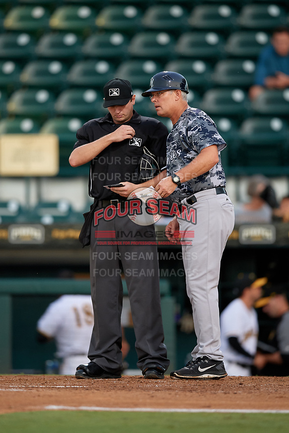 Tampa Yankees manager Jay Bell (11) talks with home plate umpire Derek Thomas during the second game of a doubleheader against the Bradenton Marauders on June 14, 2017 at LECOM Park in Bradenton, Florida.  Tampa defeated Bradenton 5-1.  (Mike Janes/Four Seam Images)