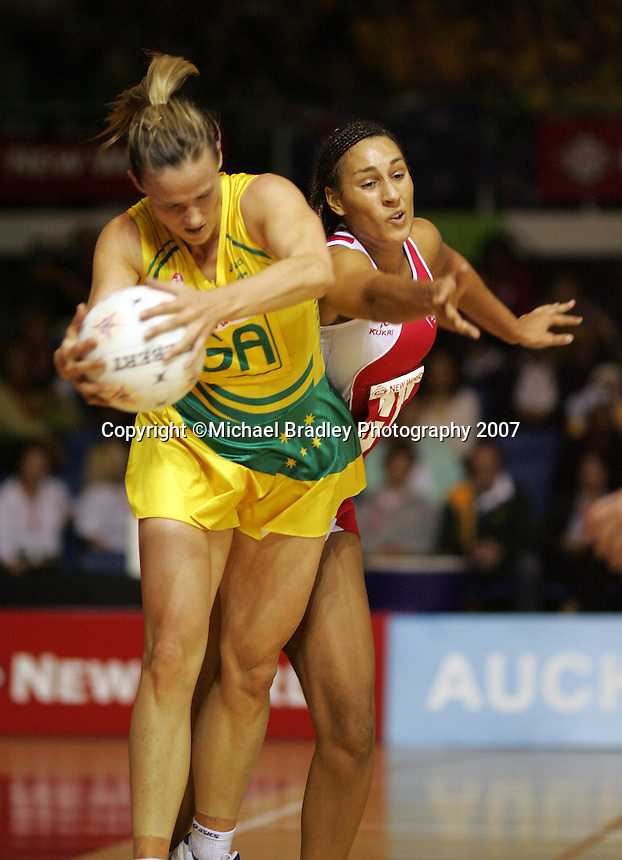 16.11.2007 Australian Sharelle McMahon and England's Geva Mentor in action during the Australia v England match at the New World Netball World Champs held at Trusts Stadium Auckland New Zealand. Mandatory Photo Credit ©Michael Bradley.