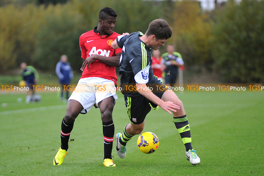 Wilfried Zaha of Manchester United battles for the ball with Alex Grant of Stoke City - Manchester United Under-21 vs Stoke City Under-21 - Barclays Under-21 Premier League Football at the Aon Training Complex - 08/11/13 - MANDATORY CREDIT: Greig Bertram/TGSPHOTO - Self billing applies where appropriate - 0845 094 6026 - contact@tgsphoto.co.uk - NO UNPAID USE