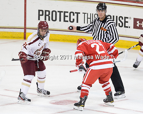 Steven Whitney (BC - 21), Chris Aughe, Cason Hohmann (BU - 23) - The visting Boston University Terriers defeated the Boston College Eagles 5-3 (EN) on Friday, December 2, 2011, at Kelley Rink in Conte Forum in Chestnut Hill, Massachusetts.