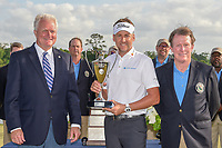 Ian Poulter (GBR) holds the trophy with members of the Houston Golf Association after winning the the Houston Open, Golf Club of Houston, Houston, Texas. 4/1/2018.<br /> Picture: Golffile | Ken Murray<br /> <br /> <br /> All photo usage must carry mandatory copyright credit (&copy; Golffile | Ken Murray)