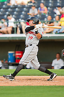 Brian Bocock (19) of the Indianapolis Indians blasts a bases loaded double off the left field wall against the Charlotte Knights at Knights Stadium on July 22, 2012 in Fort Mill, South Carolina.  The Indians defeated the Knights 17-1.  (Brian Westerholt/Four Seam Images)