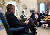 "Washington, DC - September 17, 2001 -- United States President George W. Bush meets with economic advisors in the Oval Office of the White House in Washington, DC on Monday, September 17, 2001. From right, Vice President's Chief of Staff Lewis ""Scooter"" Libby, National Economic Council Director Lawrence Lindsey and Chairman of the Council of Economic Advisors Glenn Hubbard.<br />
