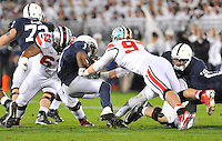 25 October 2014:  Ohio State DT Michael Mike Bennett (63) and Ohio State DE Joey Bosa (97) tackle Penn State RB Bill Belton (1). The Ohio State Buckeyes defeated the Penn State Nittany Lions 31-24 in 2 OTs at Beaver Stadium in State College, PA.