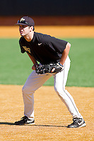 First baseman Aaron Fossas #18 of the Wake Forest Demon Deacons on defense during an intrasquad game at Wake Forest Baseball Park on January 29, 2012 in Winston-Salem, North Carolina.  (Brian Westerholt / Four Seam Images)