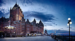 Panorama of Fairmont Chateau Frontenac castle grand hotel with dramatic deep blue sky at night, National Historic Site of Canada. Old Quebec City, Quebec, Canada. Fairmont Le Château Frontenac, Ville de Québec.