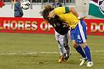 Colombian player Falcao Garcia (L) fights for the ball with Brazilian player David Luiz during their friendly match at MetLife Stadium in East Rutherford New Jersey, November 14, 2012. Photo by Eduardo Munoz Alvarez / VIEWpress.