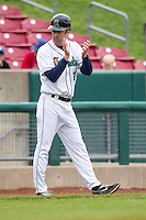 Cedar Rapids Kernels manager Jake Mauer #12 claps during a game against the Kane County Cougars at Veterans Memorial Stadium on June 9, 2013 in Cedar Rapids, Iowa. (Brace Hemmelgarn/Four Seam Images)