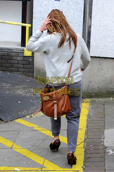 BILLIE PIPER .Arriving at the London Studios, London, England..April 15th, 2010.full length car grey gray top mulberry satchel bag brown trousers joggers back behind rear heels shoes.CAP/IA.©Ian Allis/Capital Pictures.