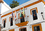 Ayuntamiento town hall building with flags in village of Alajar, Sierra de Aracena, Huelva province, Spain