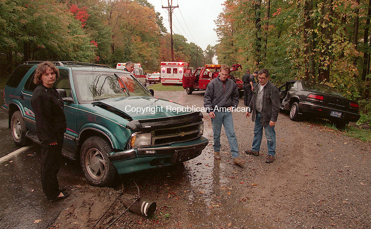 MIDDLEBURY, CT 10/10/98 --1010JH06.tif--The driver of a Pontiac Grand Prix, in rear, received minor injuries as a result of a collision with a Chevy Blazer, front, Saturday morning at the intersection of Routes 64 and 188 in Middlebury. JOHN HARVEY staff photo STANDALONE PHOTO.