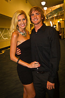 GOLD COAST, Queensland/Australia (Friday, February 24, 2012) Brett Simpson (USA) with wife Danielle Simpson (USA).  The 29th Annual ASP World Surfing Awards went off tonight at the Gold Coast Convention and Exhibition Centre with the worlds best surfers trading the beachwear for formal attire as the 2011 ASP World Champions were officially crowned.. .Kelly Slater (USA), 40, and Carissa Moore (HAW), 19, took top honours for the evening, collecting the ASP World Title and ASP Womens World Title respectively.. .I have actually been on tour longer than some of my fellow competitors have been alive, Slater said. All joking aside, its truly humbling to be up here and honoured in front of such an incredible collection of surfers. I want to thank everyone in the room for pushing me to where I am...In addition to honouring the 2011 ASP World Champions, the ASP World Surfing Awards included new accolades voted on by the fans and the surfers themselves...For the first time in several years, ASP Life Membership was awarded to Hawaiian legend and icon of high-performance surfing, Larry Bertlemann (HAW), 56...Where surfing is today is where I dreamed it should be in the 70s, Bertlemann said. You guys absolutely deserve this and Im so honored to be up here in front of you all tonight..Grammy Award-winning artists Wolfmother and The Vernons rounded out the nights entertainment which was all streamed LIVE around the world on YouTube.com..Photo: joliphotos.com