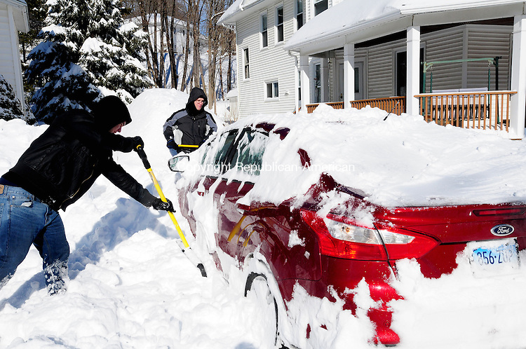 WINSTED CT, 09 FEB 13-020913AJ01-  Twins, Nik and Alex Senetcky work to clear snow around a car Saturday afternoon in Winsted.  Alec Johnson/ Republican-American