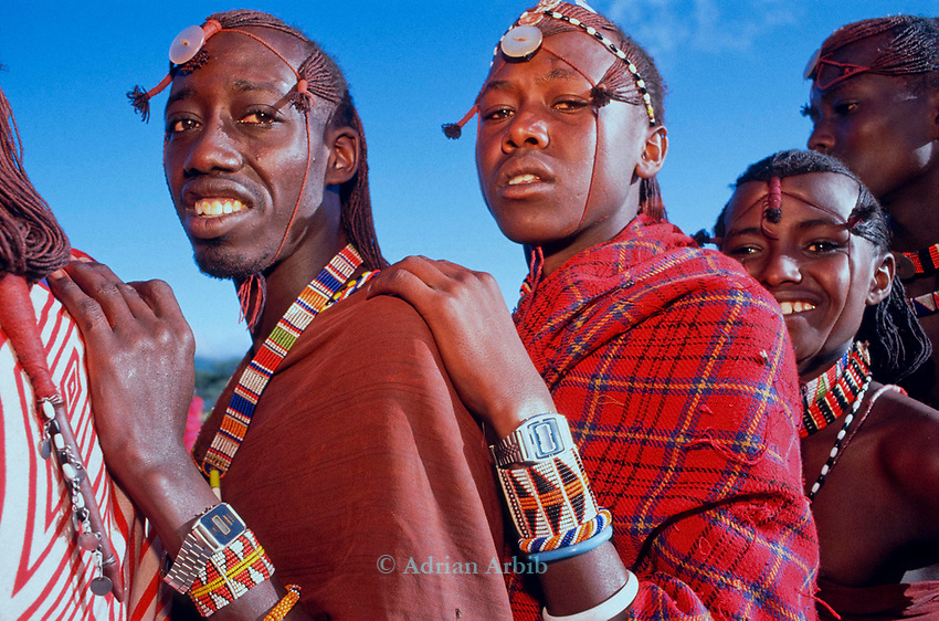 Maasai Moran stand in line to collect meat as part of the initiation into manhood of the Moran.<br />