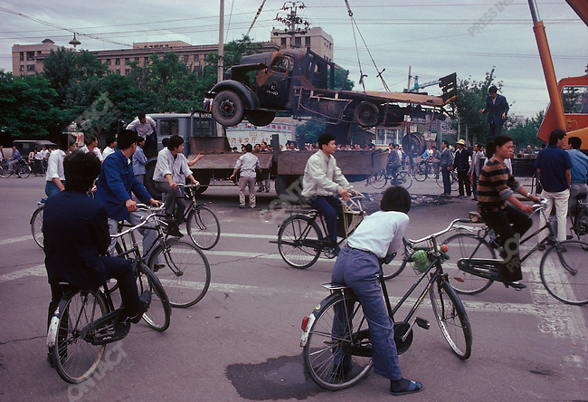 Government removes burned vehicles aftermath of military crackdown on pro-democracy protests, Tiananmen square, Beijing China, June 1989