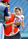 19 June 2011: Washington Nationals' pitcher Jason Marquis' daughter Alexis joins him on the field after a Father's Day game against the Baltimore Orioles at Nationals Park in Washington, District of Columbia. The Orioles defeated the Nationals 7-4 in inter-league play, and ended Washington's 8-game winning streak. Mandatory Credit: Ed Wolfstein Photo