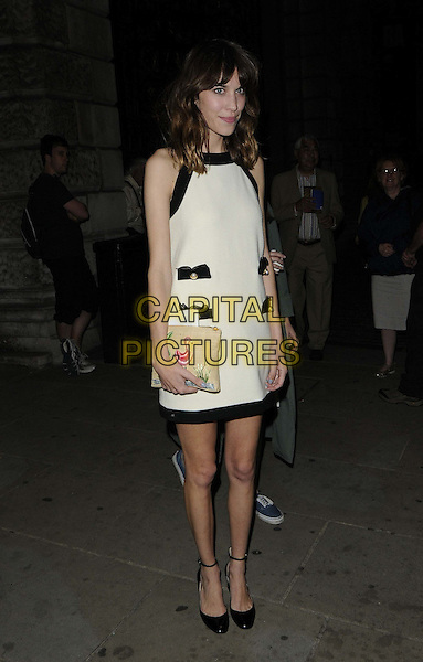 Alexa Chung.departed the Royal Academy Summer Exhibition 2012 preview party, Royal Academy of Arts, Burlington House, Piccadilly, London, England..May 30th, 2012.full length white dress ankle strap shoes black beige clutch bag black trim embroidered pockets.CAP/CAN.©Can Nguyen/Capital Pictures.