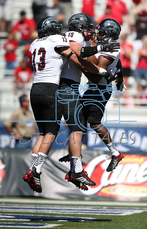 Southern Utah's Mitch Jessop (13), Chandler Allphin (19) and Chris Robinson (6) celebrate after Robinson scored in the second half of an NCAA college football game against Nevada on Saturday, Aug. 30, 2014 in Reno, Nev. (AP Photo/Cathleen Allison)