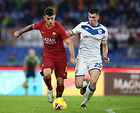 Football, Serie A: AS Roma - Brescia FC, Olympic stadium, Rome, November 24, 2019. <br /> Roma's Diego Perotti (l) in action with Brescia's Dimitri Bisoli (r) during the Italian Serie A football match between Roma and Brescia at Olympic stadium in Rome, on November 24, 2019. <br /> UPDATE IMAGES PRESS/Isabella Bonotto