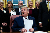 US President Donald J. Trump (C) delivers remarks during a signing ceremony for 'H.R. 724, the Preventing Animal Cruelty and Torture Act', in the Oval Office of the White House in Washington, DC, USA, 25 November 2019.<br /> Credit: Michael Reynolds / Pool via CNP