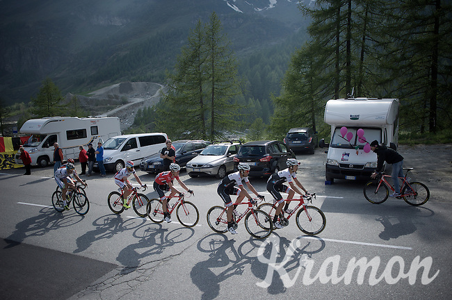 maglia rossa Giacomo Nizzolo (ITA/Trek Factory Racing) is escorted to the finish by 2 teammates and a few hangers on<br /> <br /> Giro d'Italia 2015<br /> stage 19: Gravellona Toce - Cervinia (236km)