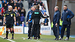 Ally McCoist held back as he remonstrates with linesman George Drummond after a Rangers goal was chalked off