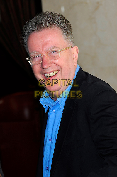 Tom Robinson.58th annual Ivor Novello songwriting and composing awards, Grosvenor House, London, England, UK, 16th May 2013..portrait headshot black blue shirt smiling glasses .CAP/CJ.©Chris Joseph/Capital Pictures.