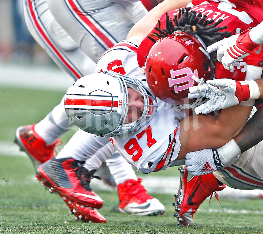 Ohio State Buckeyes defensive lineman Joey Bosa (97) takes down Indiana Hoosiers running back Devine Redding (34) in first half play at Memorial Stadium on October 3, 2015. (Chris Russell/Dispatch Photo)