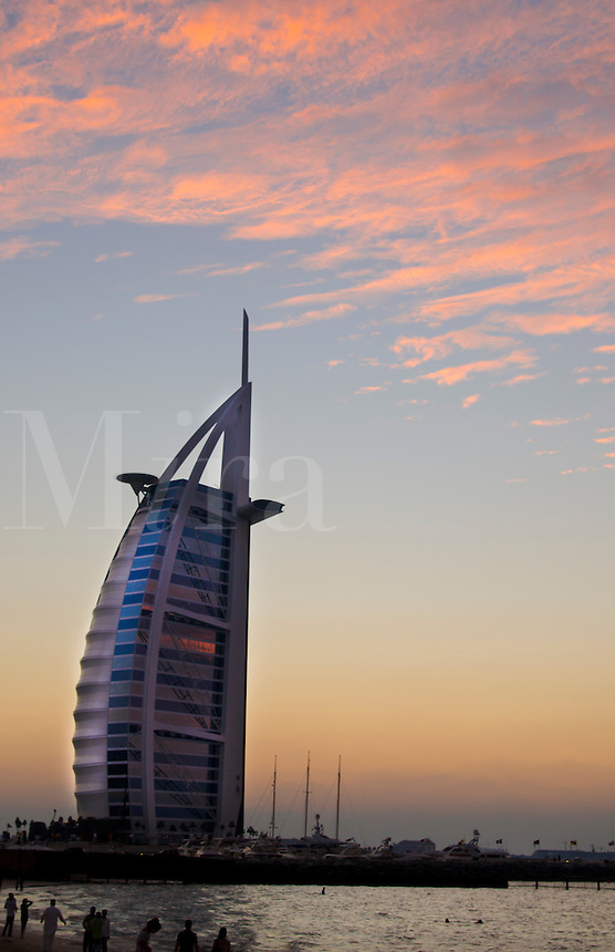 Worlds only 7 star hotel in Dubai UAE called the Burj Al Arab at sunset with luxury and water in United Arab Emirates