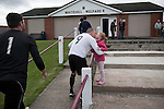 Gala Fairydean Rovers centre-forward greets daughter at the conclusion of his team's inaugural match in the Scottish Lowland Football League away to Whitehill Welfare at Ferguson Park. Gala were formed in 2013 by an a re-amalgamation of Gala Fairydean and Gala Rovers, the two clubs having separated in 1908 and Gala's Netherdale ground in Galashiels in the Scottish Borders had one of only two stands designated as listed football stands in Scotland. Whitehill won the match, the first-ever in the newly-formed Lowland League by 4 goals to 2.