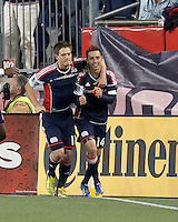 New England Revolution midfielder Diego Fagundez (14) celebrates his goal with New England Revolution midfielder Kelyn Rowe (11).In a Major League Soccer (MLS) match, the New England Revolution (blue/red) defeated Philadelphia Union (blue/white), 2-0, at Gillette Stadium on April 27, 2013.