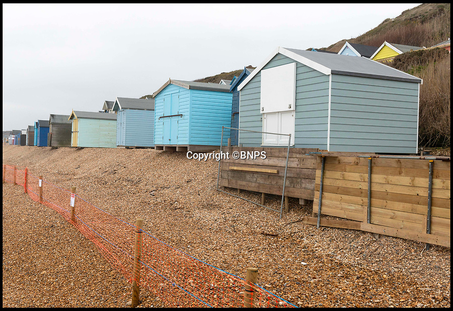 BNPS.co.uk (01202 558833)<br /> Pic:  RogerArbon/BNPS<br /> <br /> The cordon around the beach huts at the popular beauty spot.<br /> <br /> A group of beach hut owners have been evicted from a coastal beauty spot after a local council refused to replenish a shingle bank that washed away.<br /> <br /> Around 20 owners were last week given their marching orders from Hordle Cliff in Hants after coastal erosion left a 12ft drop outside the timber chalets.<br /> <br /> Some rent-payers were given as little seven days notice to vacate the pebble beach, condemning at estimated £1.1m worth of beach huts to destruction.