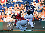 Reno Aces' David Peralta is safe at first as Sacramento River Cats' Adalberto Mejia tries to make the play at Greater Nevada Field in Reno, Nev., on Tuesday, July 26, 2016.  <br />Photo by Cathleen Allison