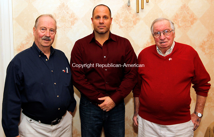 Torrington, CT- 10, November 2010-111010CM06 (L-R) Charles Heuschkel of Torrington, his son, Timothy of Simsbury, and brother Donald (veteran of Korean War) pose for a photo Wednesday night at the Elks Lodge in Torrington.  The Heuschkel family (missing Charles' son, Thomas) all served in US Marine Corps and were at the lodge celebrating the Corps' 235 birthday.   Christopher Massa Republican-American
