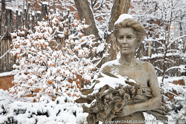 A sculpture in the garden at the Zaplin-Lampert gallery on Canyon Road in Santa Fe, New Mexico, assumes a dream-like air during a winter snowfall.