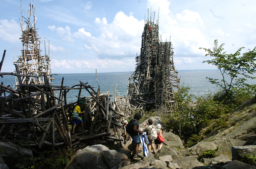 Nimis, created by arts professor Lars Vilks, is a fantascy of rickety climbable stick towers along the coast of southwest Sweden. Photo by Charles Osgood.