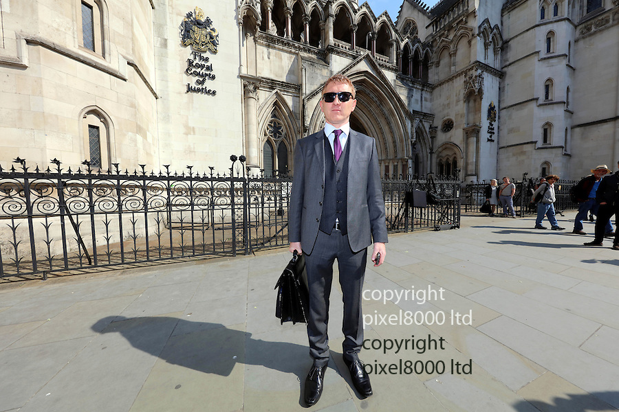 Pic shows: Jonathan Platt  centre - outside the High Court in London today after winning his case again Isle of Wight council<br /> <br /> He left with fiancee Sally Barclay - blonde woman<br /> <br /> <br /> <br /> Pic by Gavin Rodgers/Pixel 8000 Ltd<br /> <br /> <br /> <br /> Pic by Gavin Rodgers/ Pixel 8000 Ltd