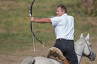 Lajos Kassai of Hungary shoots his arrow during  the European Open Championship of Horseback Archery in Veroce, about 60 km (37 miles) north of the capital Budapest, Hungary on August 31, 2012. ATTILA VOLGYI