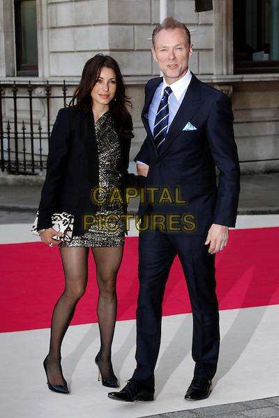 Lauren Barber & Gary Kemp.Arrivals at the Royal Academy Summer Exhibition 2012 - preview party held at the Royal Academy of Arts, London, England..May 30th, 2012.full length black dress blazer silver gold suit blue shirt married husband wife.CAP/AH.©Adam Houghton/Capital Pictures.