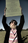 An old man with a long beard protesting in the countryside Suffolk England