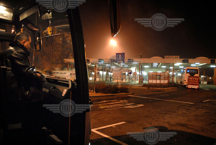 A Romanian bus waits at the Nadlac customs border with Hungary.